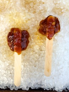 Freshly made maple lollipops sit on ice